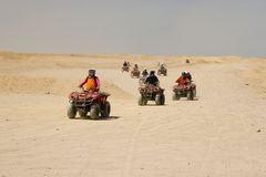 Race on quad in desert Stock Photo