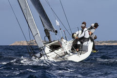 Race. Regatta boat while dating upwind Stock Photos