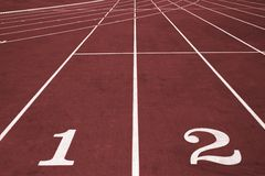 Race running track. Running lanes with numbers on the stadium royalty free stock photography