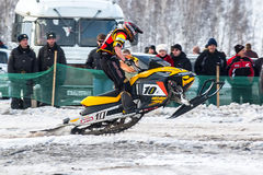 Race of sportsman on snowmobile Stock Images