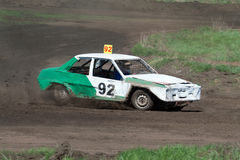 Race for survival. Green white car. On the track Stock Images