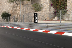 Race track. With indication of 100 meter left to the next curve royalty free stock image