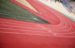 Race track. Racetrack with a corner of green football field stock photography