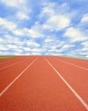 Race track with cloudy sky Stock Photos