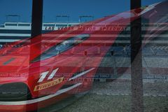 At the Race Track in Las Vegas. A Ferrari racecar is superimposed on an image of the Las Vegas Motor Speedway in Nevada stock photos
