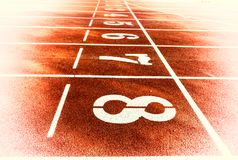 Race track for running competitions numbers and lanes Royalty Free Stock Images