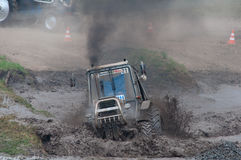 Race of tractors in the mud. Rostov-on-Don, Russia, July 5, 2016, Beezotrek show royalty free stock photo