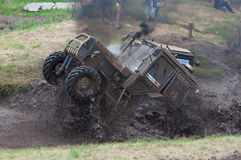 Race of tractors in the mud. Rostov-on-Don, Russia, July 5, 2016, Beezotrek show Stock Photography