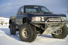 Race truck parked in snow Stock Photography