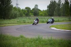 Race between two motorcycle athletes royalty free stock photography