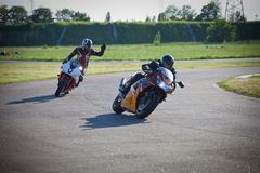 Race between two motorcycle athletes stock photos