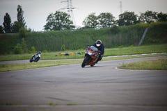 Race between two motorcycle athletes. Motorcycle sport. FIM Road Racing stock photo