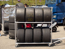 Race tyres are stalled behind the pitlane during a race Royalty Free Stock Photo