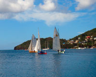 A race using traditional caribbean dinghies Stock Photography