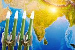 Race of weapons, nuclear weapons, the threat of war in the world. Rockets on the background of India. Stock Image