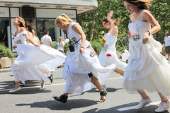 Race in the wedding dresses Royalty Free Stock Images