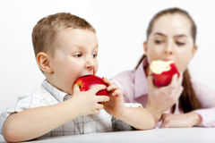 The race: Who  the first  will eat apple. Stock Image