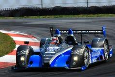 Raceauto op spoor stock foto's
