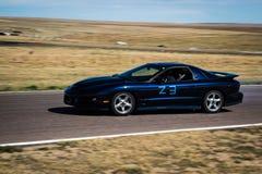 Racebil på spår Royaltyfri Fotografi