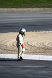 Racecar driver walking Stock Photography
