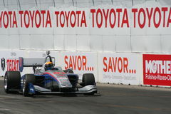 Racecar. Race car coming around the corner at the Long Beach Grand Prix on 4/17/15 Royalty Free Stock Images