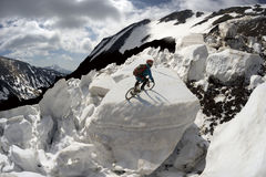 racer on avalanche Stock Photo