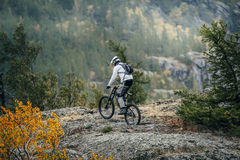 Racer bike. Racer on a bike stopped at the edge of the mountain stock image