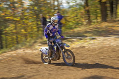 Racer in blue is riding motorcycle Stock Photography