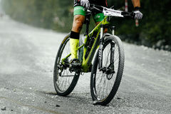 Racer cyclist mountainbiker downhill on gravel road Royalty Free Stock Photo
