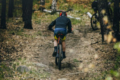 Racer cyclist uphill Stock Photography