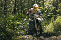 Racer Enduro overcomes mud puddle Stock Image