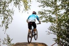 Racer extreme athlete jump on bike Stock Photos