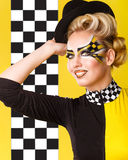 Racer Girl corrects hat. Royalty Free Stock Images