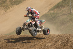 Racer is jumping a quad bike Royalty Free Stock Photos