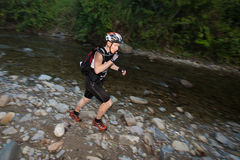 Racer makes  way across a river in the morning Royalty Free Stock Photos