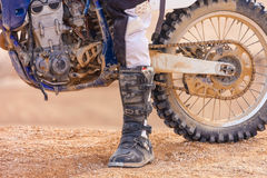 Racer on a motorcycle in the desert. In summer Royalty Free Stock Image
