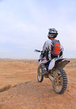 Racer on a motorcycle in the desert Stock Photo