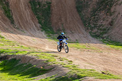 Racer on a motorcycle in the desert Stock Images