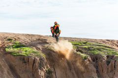 Racer on a motorcycle in the desert Stock Photos
