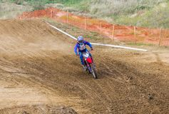 The racer on a motorcycle participates in race motocrosses, goes on sand. Stock Photography