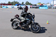 The racer on a motorcycle rides on the speed of the track Stock Images