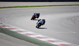 The racer on a motorcycle rides on the speed of the track Royalty Free Stock Photo