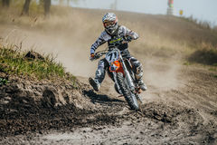 Racer on a motorcycle turns on a dusty race track Stock Photo