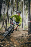 Racer on mountain bike rides on a u-turn Royalty Free Stock Image
