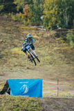 Racer on the mountain Biking jumps from a springboard Stock Images