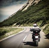 Racer on mountainous highway Royalty Free Stock Photos
