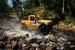 Racer off road at terrain racing car competition Royalty Free Stock Images