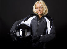 Racer is posing. Sexy girl racer holding her helmet and posing Stock Photography