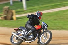 Racer at the pro track. Motorcycle racer at the pro motorcycle racing event on the dirt oval flat track speedway, Ashland County, Ohio, USA royalty free stock photos