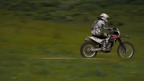 Racer rides at high speed stock video